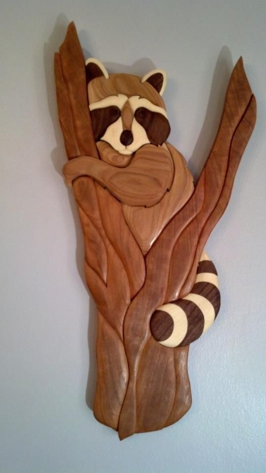 Treed Raccoon.  hand made using only natural colors of the wood.  This one is hickory, cherry,basswod, walnut, and wenge    www.the-cut-above.com