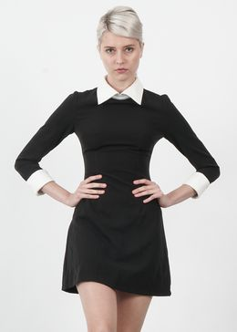Channel your inner Wednesday Addams in this 60's inspired dress. Black dress with cream peter pan collar. Pair with our Paige Ankle Boot. Returns and Exchanges Policy Shipping Specifications: - Item s
