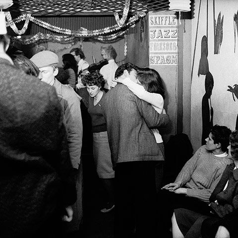 Credit: Bob Collins/Museum Of London A couple kissing at a skiffle club in Soho, 1959