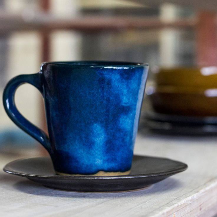 Sapphire Blue Mug and Matte Black Saucer Hand crafted ceramics made in Cape Town, South Africa. Contact us or for more information visit www.mervyngers.com