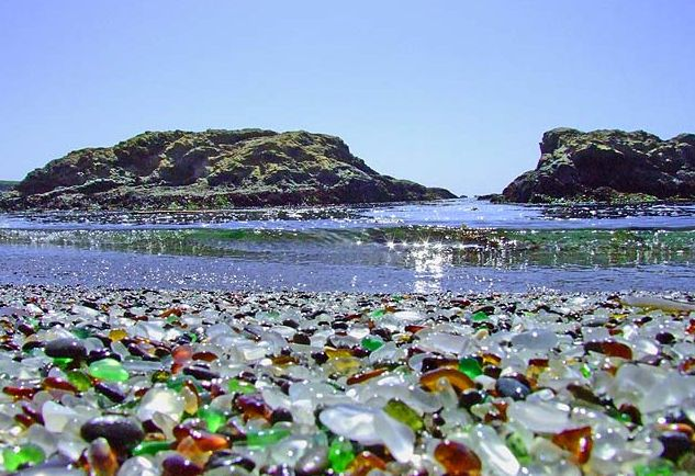 glass beach, ca. Up until the late 1960s, folks would hurl their refuse – including old cars and appliances – straight over the cliffs and into the oceans. Finally the authorities put a stop to it. Over the ensuing decades, the sea performed a remarkable conjuring act, acting like a huge tumbler to winnow out the glass and turn it smooth. These days the beach resembles a gem shop.