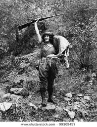 Vintage woman deer hunter photo
