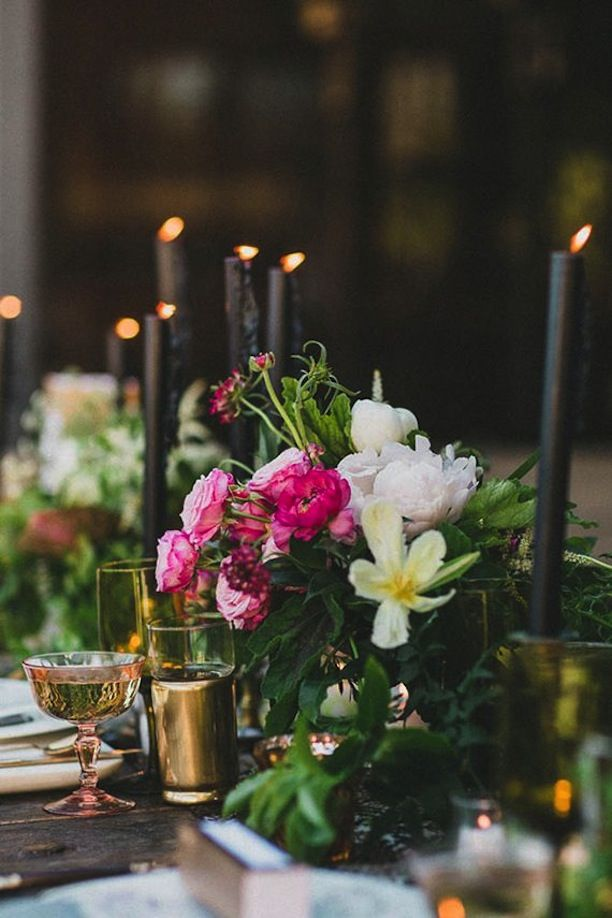 black taper candles + white and pink flower // beautiful unexpected table setting
