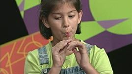 In this video segment adapted from ZOOM, two cast members make a simple musical instrument from a straw. Through their exploration, they discover that pitch -- how high or low a sound seems -- can be altered by simply shortening the straw. This demonstrates the direct relationship between pitch and the amount of vibrating air contained in a musical instrument.
