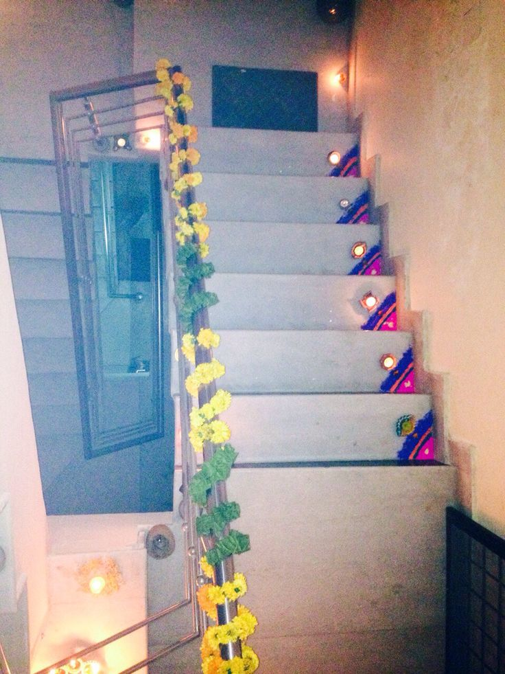 Stairs to home. #Diwali #rangoli #diyas