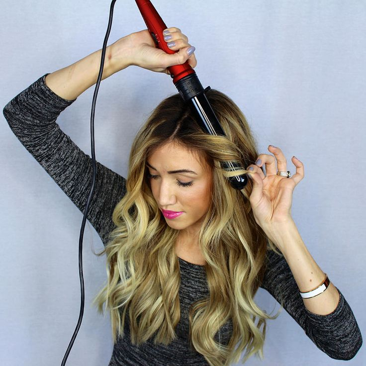 Just like with all curling techniques, the beach waves start with the right tool. Desiree Hartsock uses a wand to get her effortless look, and we agree it's the easiest method. You'll want to curl 1 inch sections, holding it facing down. Finger comb your hair once your whole head is done for a lovely, laidback look.