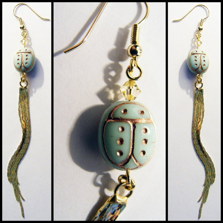Queen of the Jungle: Statement earrings with mint green ladybugs and gold tassels.
