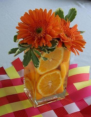 orange and lemon slices centerpiece | centerpiece with dahlias, Black Magic roses, yellow roses, orange ...