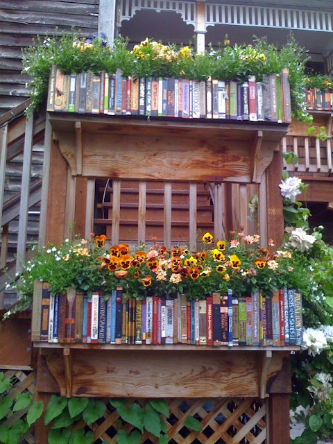 Fairy Tales in the Garden? The looks of a Bookshelf, but beware plants don't read much....... but you can do it! Start reading and after that use the books to make this, to show off your cherished plants ;-)