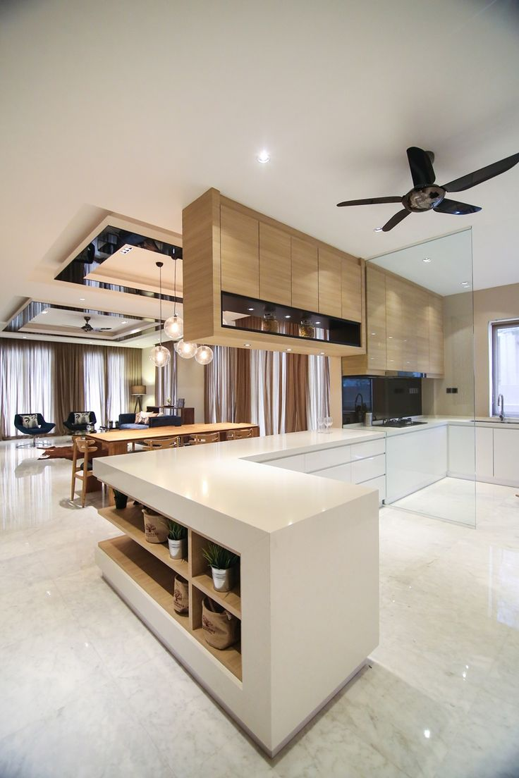 Open dry and wet kitchen spaces combines a mix of light timber ceiling mounted cabinets combined with a modern white base cabinet design