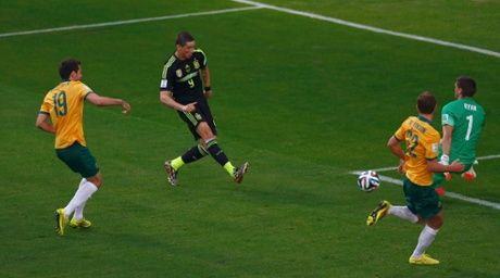 Fernando Torres scores a smart goal past Australia's goalkeeper Mathew Ryan in Spain's 3-0 win.