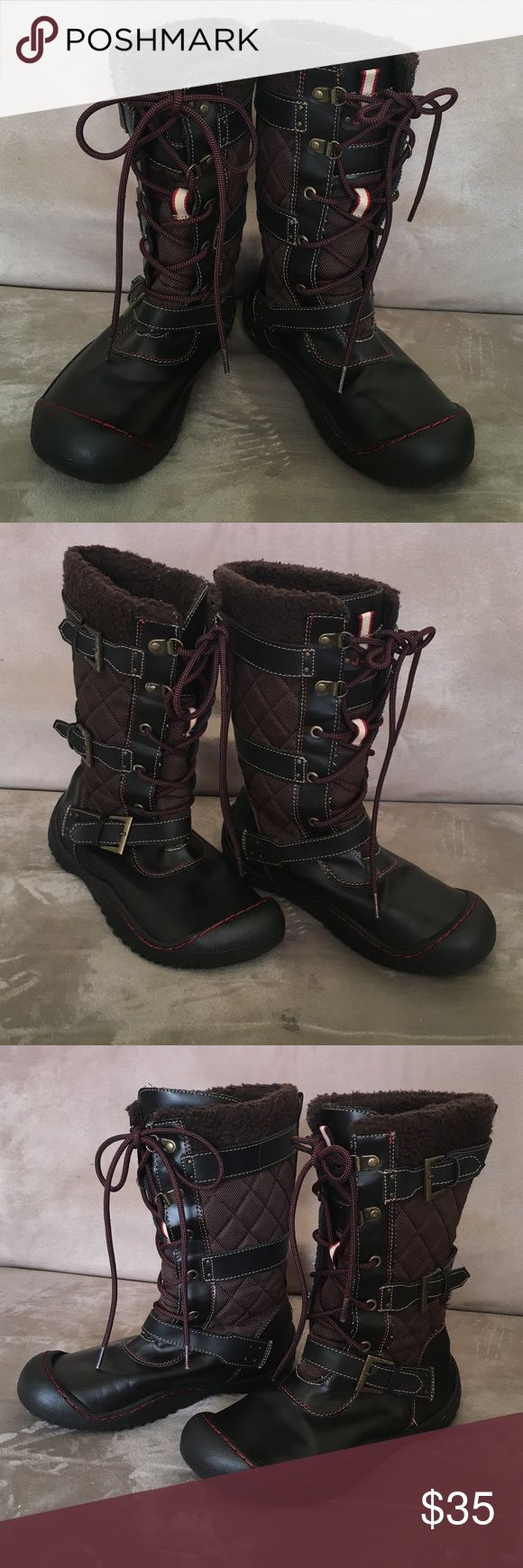"J-41 Vegan 6.5M Winter Boots Lace Up Brown Stylish comfortable cozy and practical Jay – 41 vegan lace up winter boots and a size 6.5 medium. These Booch featured jeep engineered traction sole lace up front with cross over accent buckles and faux fur top line. Boots are 11"" tall and lace up front provides for adjustable calf width ranging from 13""-17"". J-41 Shoes Winter & Rain Boots"