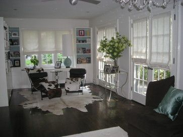 Unlined linen Roman shades add privacy but still filter light for this modern style sunroom. The front window had a triple Roman. Rosemarie Garner