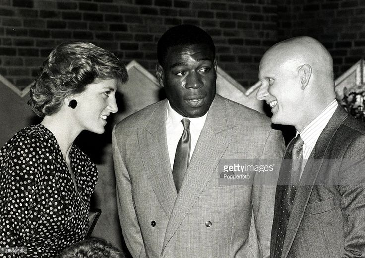 3rd October 1988, HRH Diana, The Princess of Wales chats to former Olympic swimmer Duncan Goodhew (right) and heavyweight boxer Frank Bruno at a London sports reception