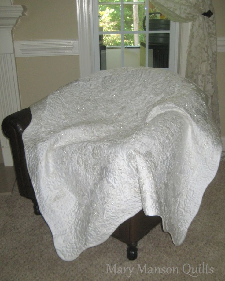 This quilter makes beautiful quilts from wedding gowns.  http://marymansonquilts.blogspot.com/p/blog-page_19.html