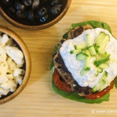 Black olive and feta turkey burgers topped with greek yogurt sauce and pickles