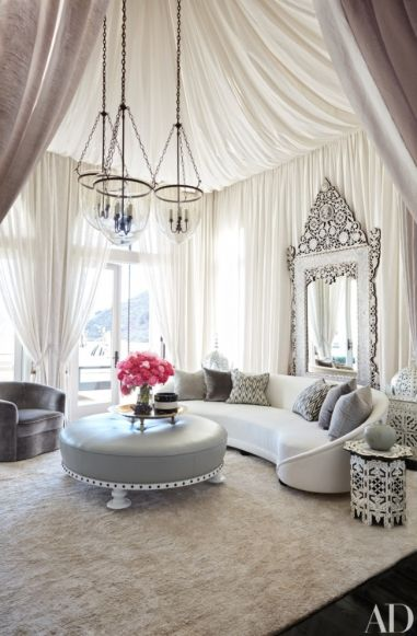 "At home with Khloé and Kourtney Kardashian: Bullard provided all the exotica Khloé coveted, dressing her home in a kaleidoscopic array of Moroccan, Turkish, and Middle Eastern flourishes. His coup de théâtre is the tented living room—an ethereal white fantasy presided over by a massive Levantine mirror with silent-film-era allure. That parlor opens onto a vine-covered terrace, where hanging daybeds sway gently in the Pacific breezes. As Bullard explains, ""Khloé wasn't interested in a…"