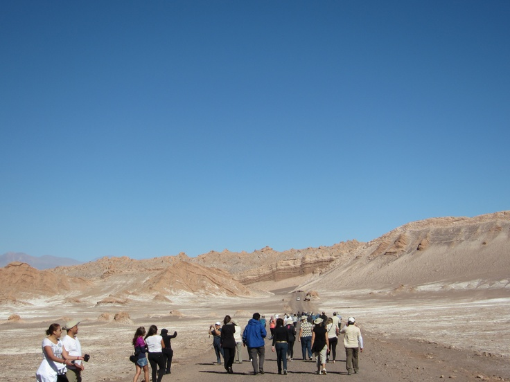 Taking a break from the buses and strolling along the road in the Moon Valley. Photo by CD.