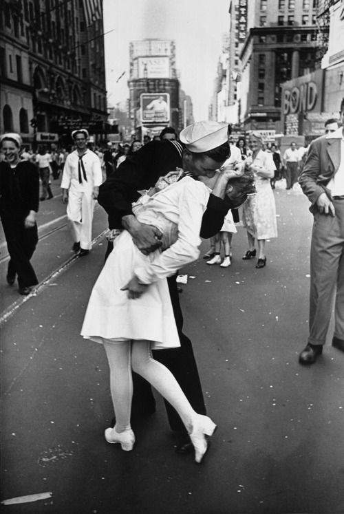 Nothing says romance quite like this image by LIFE's Alfred Eisenstaedt.    Pictured: On August 14, 1945 — VJ Day — a jubilant sailor plants a kiss on a nurse in Times Square to celebrate the Allies' long- awaited World War II victory over Japan.