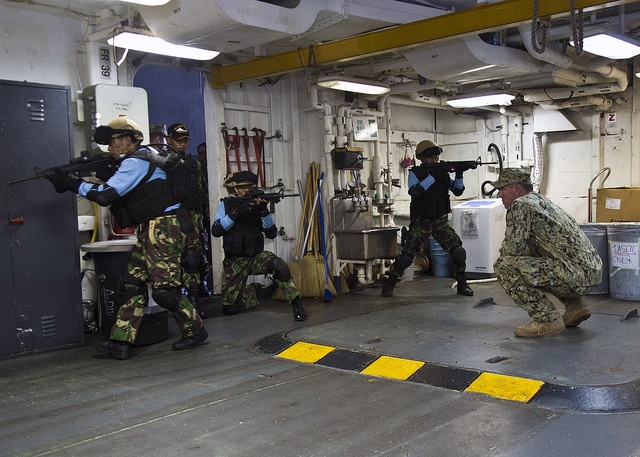 JAVA SEA (May 24, 2013) Members of the Indonesian special forces unit Kopaska simulate seizing a room while being observed by ET1st Class Anthony Nekervis, assigned to Maritime Civil Affairs and Security Training (MCAST), during a joint Visit, Board, Search, and Seizure (VBSS) exercise aboard the amphibious dock landing ship USS Tortuga (LSD 46) as a part of Cooperation Afloat Readiness and Training (CARAT) 2013. More than 1,000 Sailors and Marines are participating in CARAT Indonesia 2013.