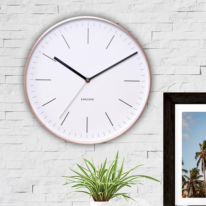 "<p><span style=""font-size: medium;""><strong>KARLSSON MINIMAL WHITE WALL CLOCK WITH COPPER CASE 27CM</strong></span></p> <p>To steal a line from Zoolander's Mugatu: that Karlsson Minimal Wall Clock's so hot right now. <br /><br />With its copp"