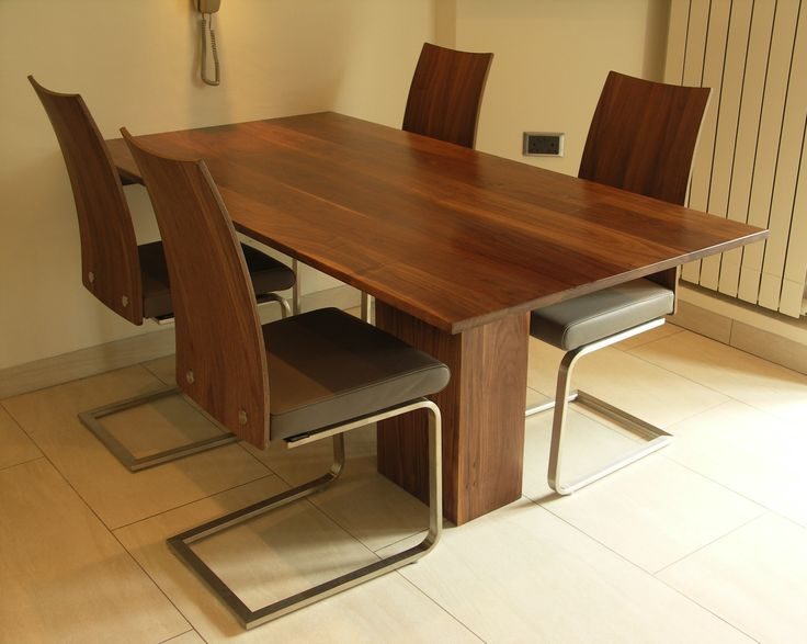 American Black Walnut Dining Table with matching cantilever chairs.