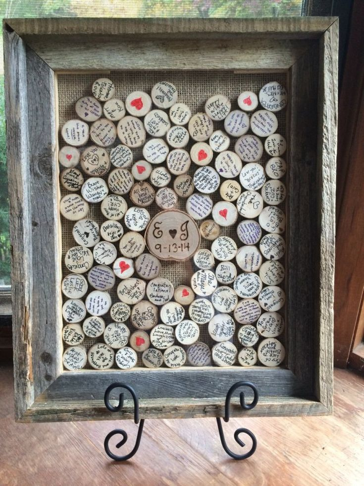 This cute guest book idea is a shadow box with a drop slot for these round wood pieces to go.  Makes a great wall hanging after the wedding! | http://emmalinebride.com/reception/date-jar-guest-book/