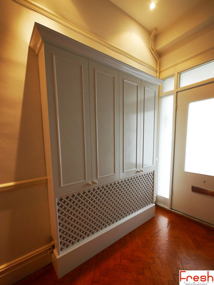 Coat and shoe storage unit, Blum soft close hinges and integral radiator cover, hand painted water based gloss. Fresh Interior - Bespoke Storage Solutions - London