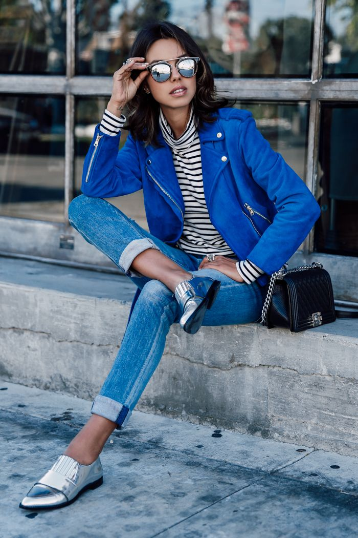 Cobalt blue biker with striped top, blue jeans and silver shoes.
