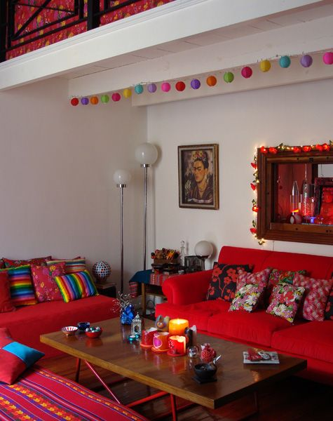 Love the red against the white walls and the multi coloured pillows and lights