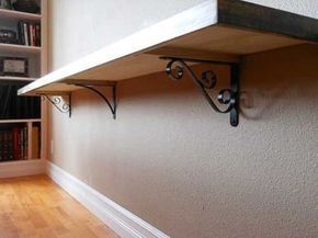 Mounted Sofa Table. What a great idea for behind the couch in the family room!