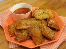 Toasted Ravioli : Jeff Mauro saves time in the kitchen by starting with a package of frozen ravioli to make this 15-minute starter. After breading the cheesy bites, he fries them until they're golden brown and crispy, then serves them with marinara sauce for dipping.