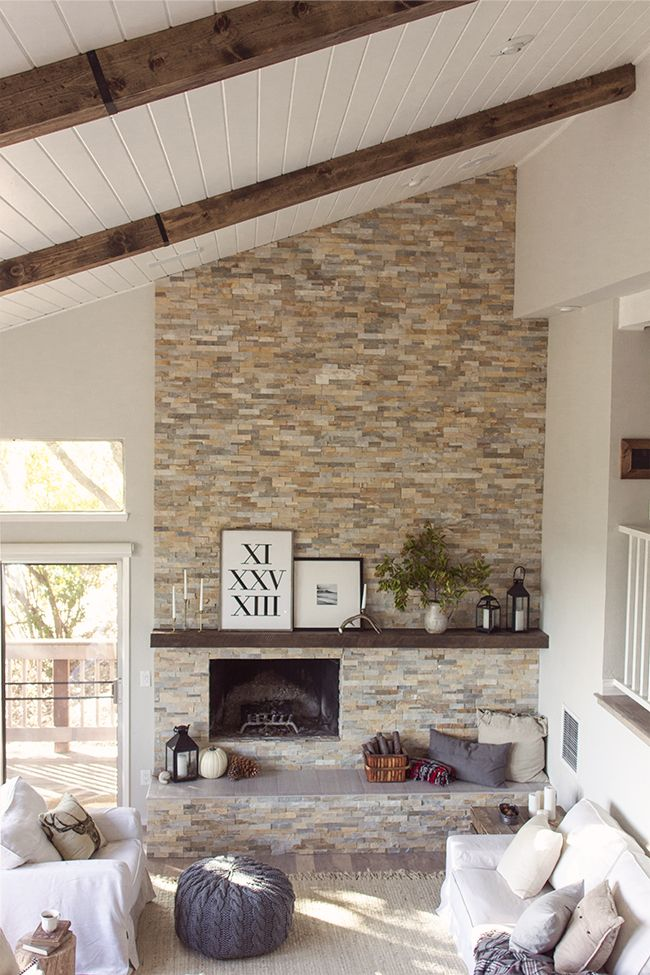 Gorgeous home tour featuring tons of DIY ideas on a budget - love the floor to ceiling tile fireplace and the plank ceiling eclecticallyvintage.com