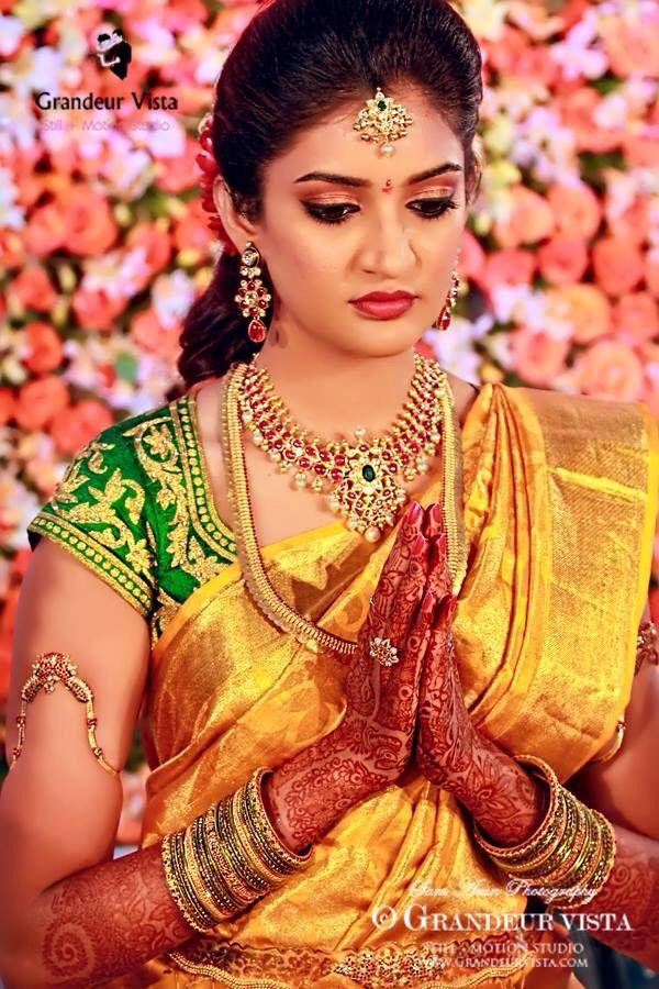South Indian bride. Temple jewelry. Gold silk kanchipuram sari with contrast green blouse.Braid with fresh flowers. Tamil bride. Telugu bride. Kannada bride. Hindu bride. Malayalee bride.