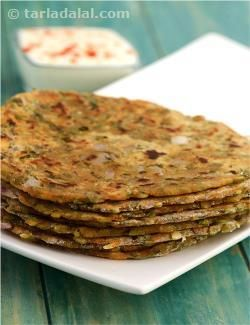 Healthful moong dal takes the form of a tasteful paratha here! Cooked moong dal, along with potato for binding, onions for crunch and a range of spices for added flavour, makes a great stuffing for parathas that are crisp from outside and soft inside. You will enjoy the unique combination of spices in this protein and iron rich paratha, especially the thoughtful addition of crushed coriander seeds and amchur.
