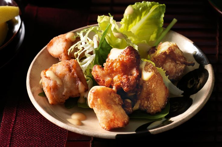 crispy fried chicken marinated in soy and ginger.