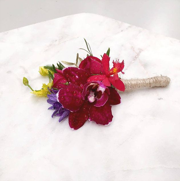 Buttonhole, Grooms flowers, Theme- Beach wedding. Bright colours with a hint of gold sprayed leaves. Tropical vibe.   Colours- Orange ,yellow, reds, Pink, blue, purple, greens.