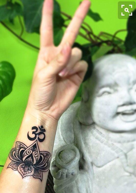 Lotus and ohm tattoos #tattoo #ohm #lotus #spiritual #forearm #arm…