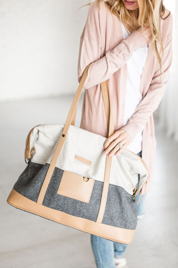 """Oversized boiled wool weekender bag with removable and adjustable cotton canvas body strap. Features include a credit card holder, genuine leather accents and feet on the bottom. - 20.5"""" x 16.5"""" x 8.5"""