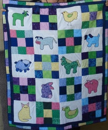 Farm animal baby quilt; could create with large print blocks instead of