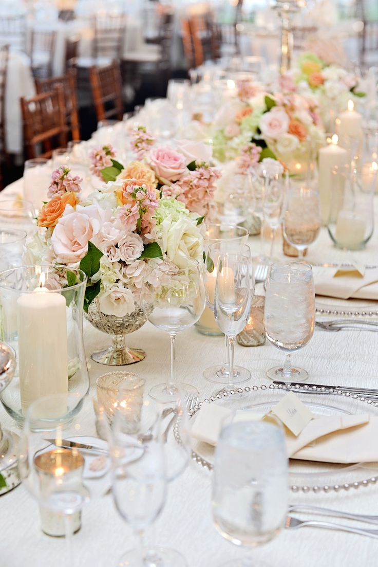 A gorgeous lakefront ceremony tented reception with for Glass tables for wedding reception