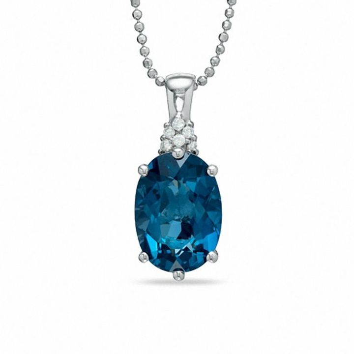 Zales Oval London Blue Topaz Pendant in Sterling Silver with Diamond Accents