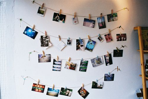 clothesline pictures, you can DIY this using twine, clothespins, and pics! may have to use strong clear tape to adhere the lines to the wall, pins may damage the rental property