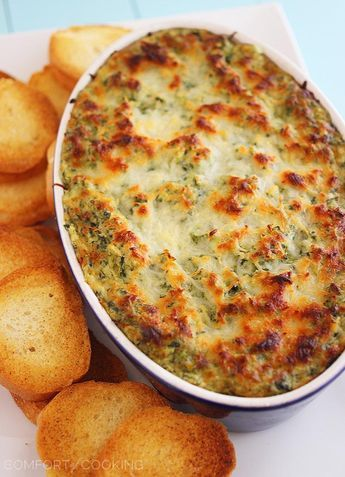 Hot Cheesy Spinach-Artichoke Dip – Super easy, cheesy dip that pairs perfectly with toasty baguettes, crackers and pretzels! | thecomfortofcooking.com