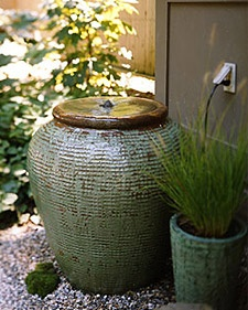 Greet guests with the tranquil sound of falling water in a pump-fitted urn with a motor that moves the water underground.  Instructions on link