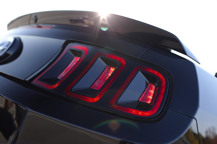 2013 Ford Mustang: The rear of the 2013 Mustang has been updated with a high-gloss black panel that connects the taillamps. Keeping the sequential turn signal Mustang is known for, the taillamps also deliver a smoked appearance that matches the more purposeful look up front.