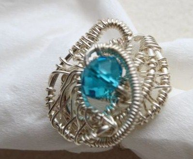 Silver wire wrapped ring .Designed by AngelaAndTedDesigns