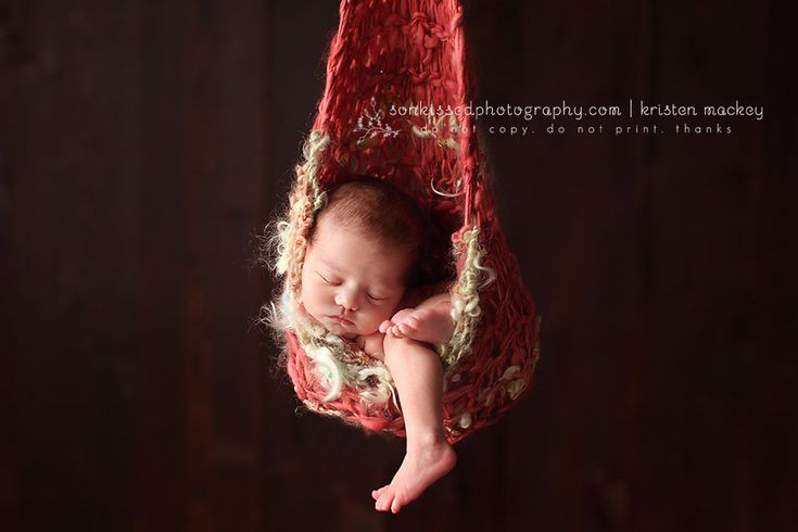 One of the only photographers who does the hanging shot well  .with baby looking totally relaxed and not awkward.