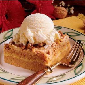 Great Pumpkin Dessert* (5 minute prep time!)       1 can (15 ounces) solid-pack pumpkin      1 can (12 ounces) evaporated milk      3 eggs      1 cup sugar      4 teaspoons pumpkin pie spice      1 package (18-1/4 ounces) yellow cake mix      3/4 cup butter, melted      1-1/2 cups chopped walnuts      Vanilla ice cream or whipped cream