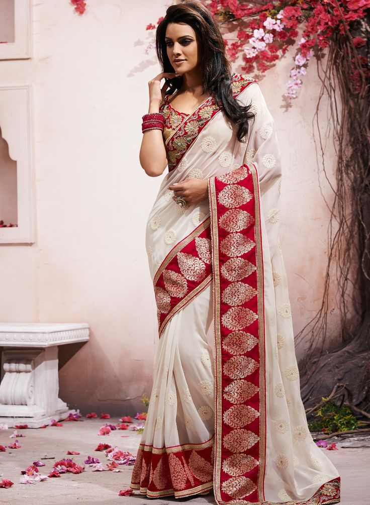 Gets your partner's heart thumping when he sees you in this classy Embroidered saree. SHOP NOW!